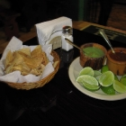 Nachos, limón, salsa verde and salsa roja