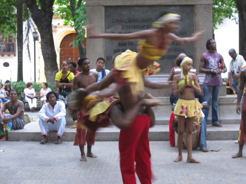 Dancing in the street (the guy is holding two dancers!)