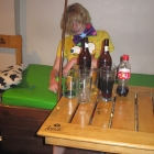 This is semi-staged: the drunk guy was there, but Chris from Loki put all the bottles and gadgets. [bigchris@lokihostel.com]